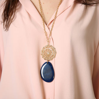 Pendant in golden color. Carabiner closure. Detail of rose window plus blue stone. - O'Livia
